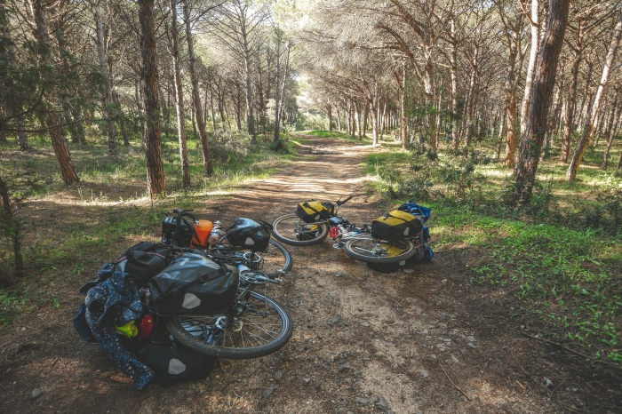 Riding through a protected forest in Sardina can only be done with bigger tires